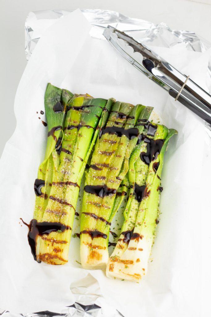 sliced leeks with seasoning in baking pan