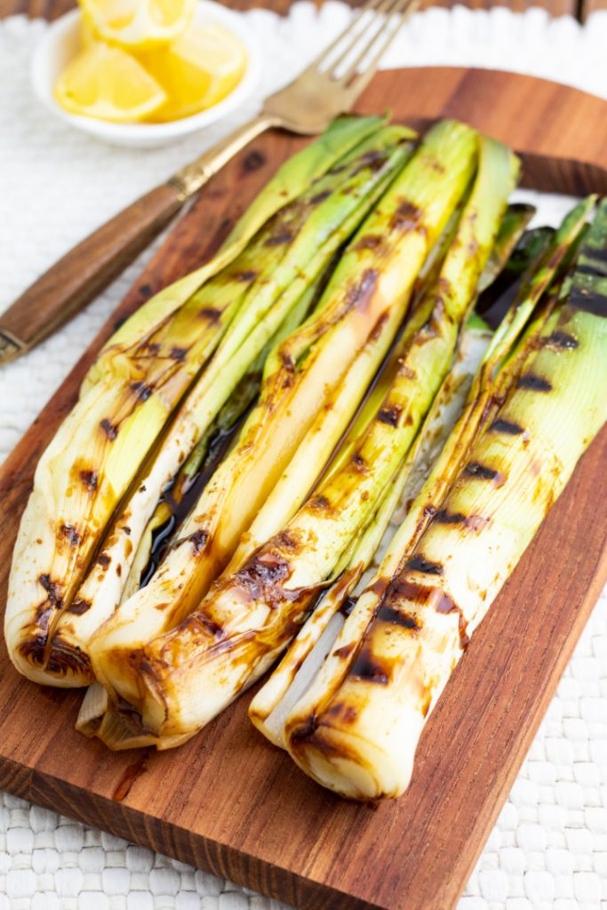 leeks with grill lines on wooden board