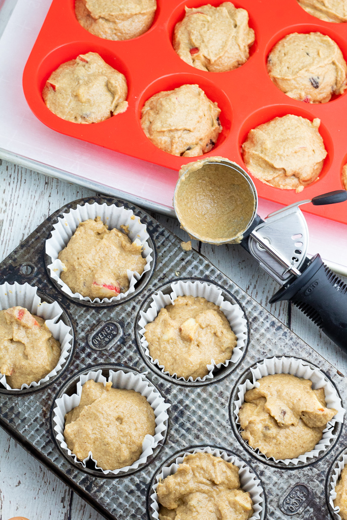 overhead photo of tin muffin pan and silicone muffin pan filled with vegan muffin batter