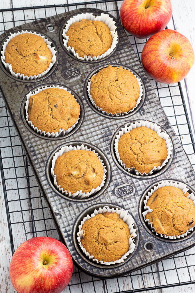 old tin muffin pan filled with cooked vegan muffins on cooling rack