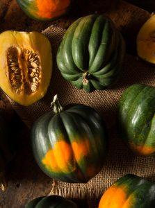 Raw Organic Green and Orange Acorn Squash