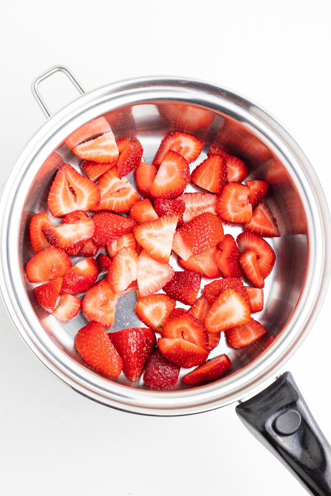 stainless pot with chopped strawberries