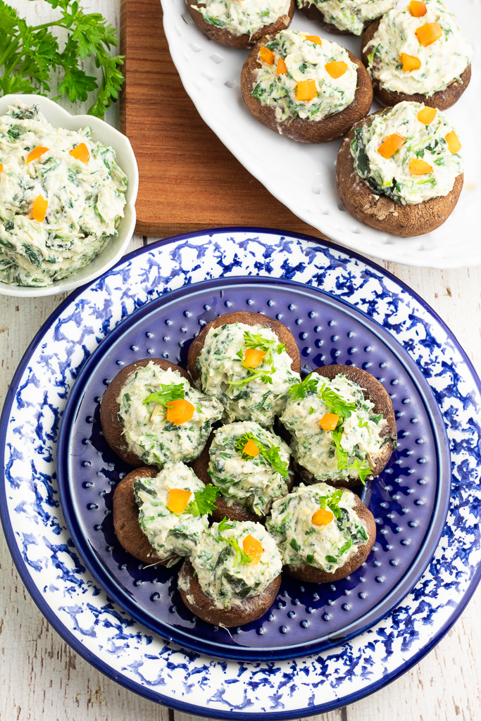 bright blue and white plate with stuffed mushrooms